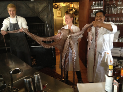 Executive Chef Jonah Rhodehamel, Sous Chef Natalie Nesbit and Senior Line Cook Adelino Perez Cisneros hold the 60 pound octopus from the waters off the coast of Mendecino